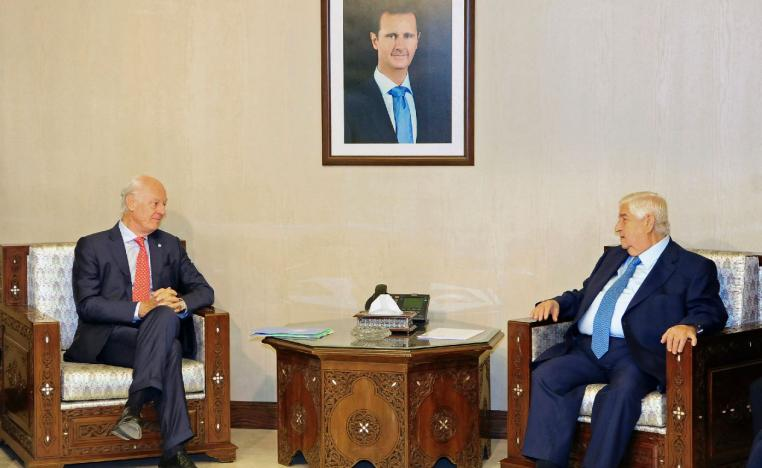 Syria's Foreign Minister Walid al-Muallem, right, meets with UN Special Envoy for Syria Staffan de Mistura.