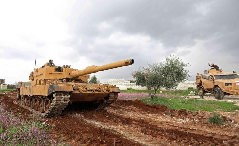 A Turkish military tank is seen during battles between Turkish-led forces and Kurdish fighters.