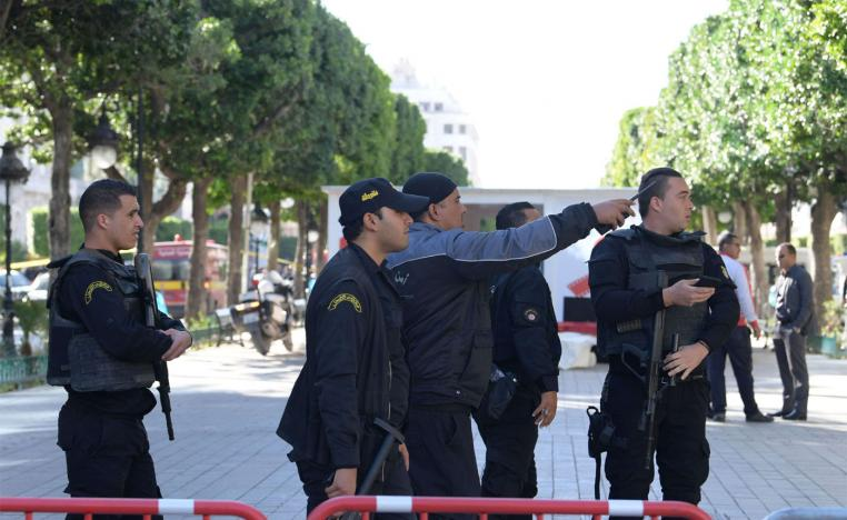 Tunisian police gathering at the site of a suicide attack in the centre of the Tunisian capital Tunis
