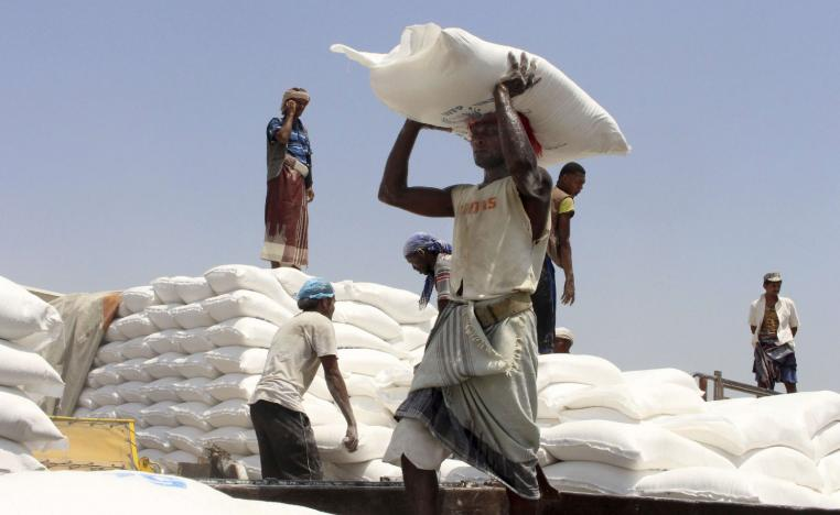 Men deliver UN World Food Programme (WFP) aid in Hajjah, Yemen.