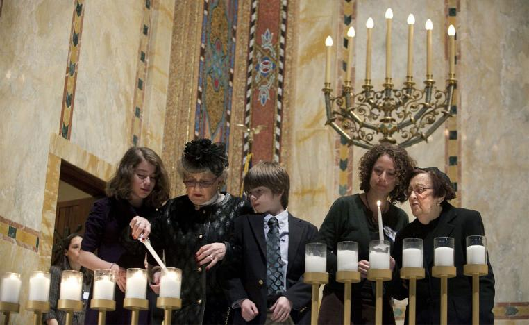 Holocaust survivors light symbolic candles at the Temple Emanu-El during the annual Holocaust Remembrance Day in New York