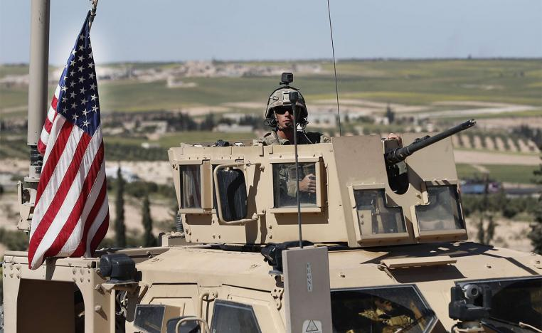 US soldier sits in an armored vehicle
