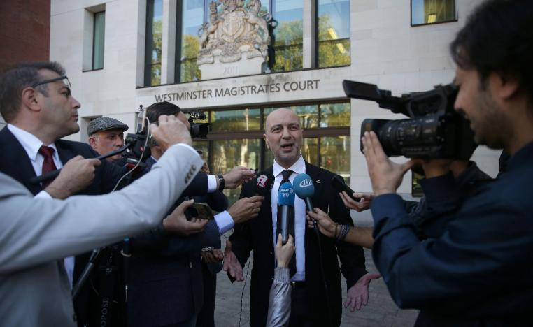 Turkish businessman Akin Ipek speaks to members of the media as he leaves after appearing at Westminster Magistrates Court in London on September 25, 2018.