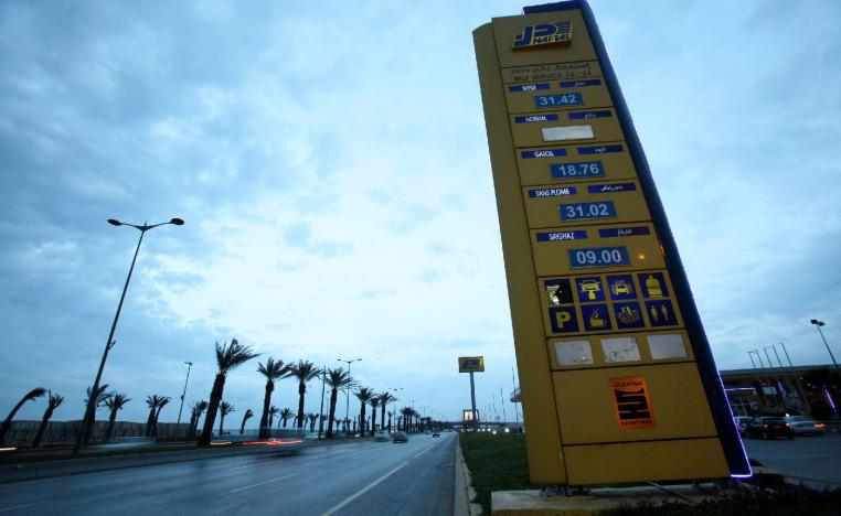 A Naftal billboard shows prices at the entrance of the fuel station in the highway of Algiers, Algeria February 3, 2016.