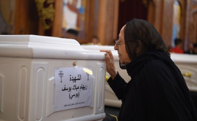 A relative of a slain Christian grieves during funeral service in Minya, Egypt.
