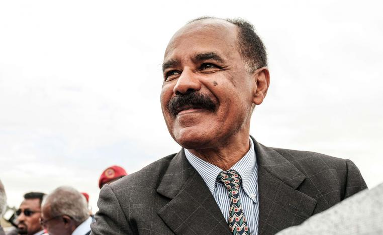 Eritrea's President Isaias Afwerki smiles upon his arrival at the airport in Gondar