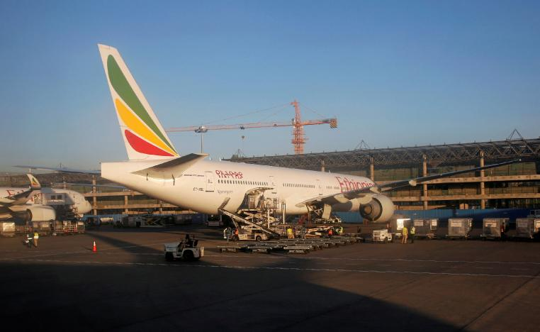 Workers service an Ethiopian Airlines plane at the Bole International Airport in Ethiopia's capital Addis Ababa