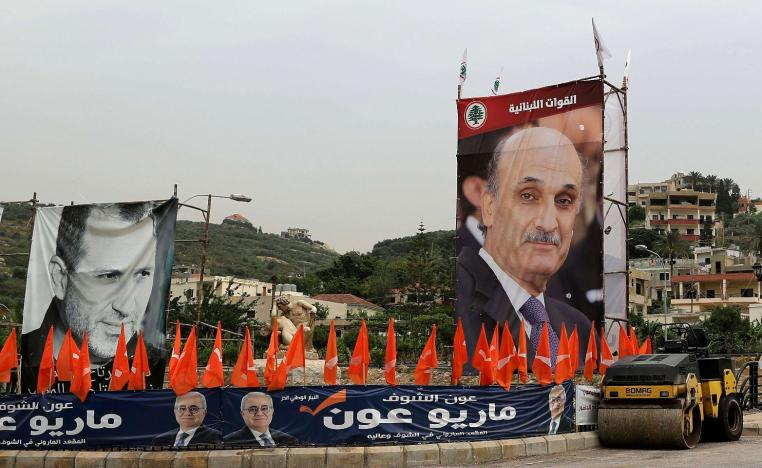 Portraits of the Free Patriotic Movement (FPM) candidate, Foreign Minister Gibran Bassil (L) and the leader of the rival Christian Lebanese forces (LF) group, Samir Geagea (R).
