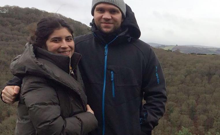 Photo released by the family of British student Matthew Hedges shows him (R) and his wife Daniela Tejada (L) posing in an undisclosed location.