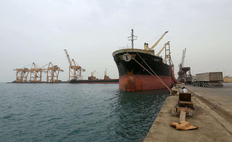 A ship carrying a shipment of grain is docked at the Red Sea port of Hodeidah