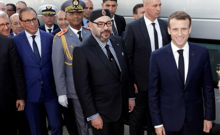 French President Emmanuel Macron (R) and Moroccan King Mohammed VI (C) attend the launch ceremony in Tangiers.