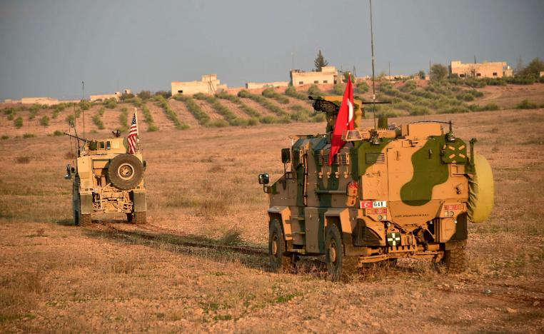 Turkish and U.S. troops are pictured during a joint patrol in Manbij area, northern Syria November 8, 2018.