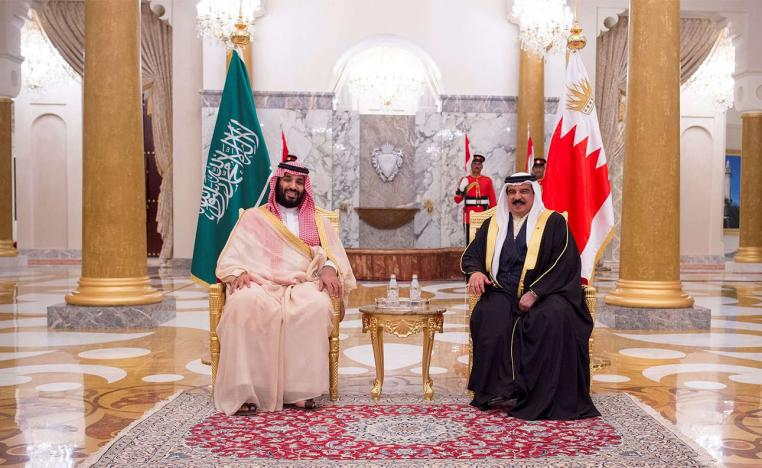 Saudi Arabia's Crown Prince Mohammed bin Salman Al Saud is received by Bahraini King Hamad bin Isa Al Khalifa in Manama