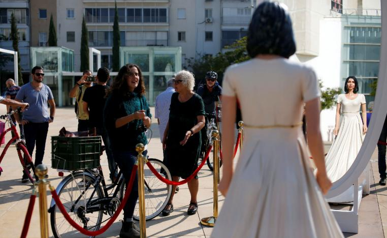 People look at an installation, including a statue resembling Israeli Minister of Sports and Culture, Miri Regev, in Tel Aviv, Israel on November 8, 2018.