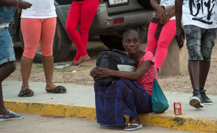 A Sub-Saharan migrant sits as she waits to leave the temporary centre for immigrants and asylum seekers in the Spanish enclave of Melilla on September 19 , 2018.