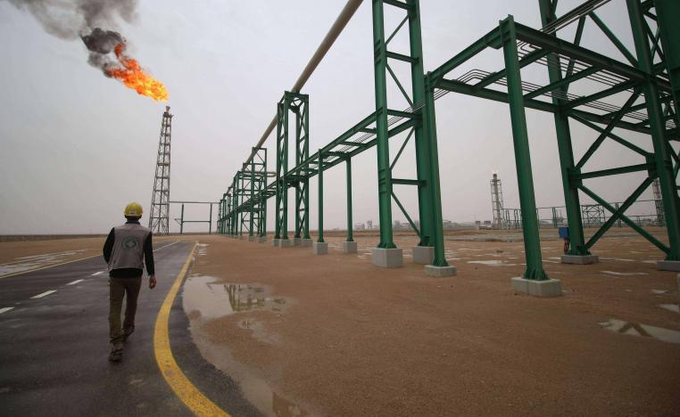 An employee walks at the Zubair oil and gas field in Basra, last May
