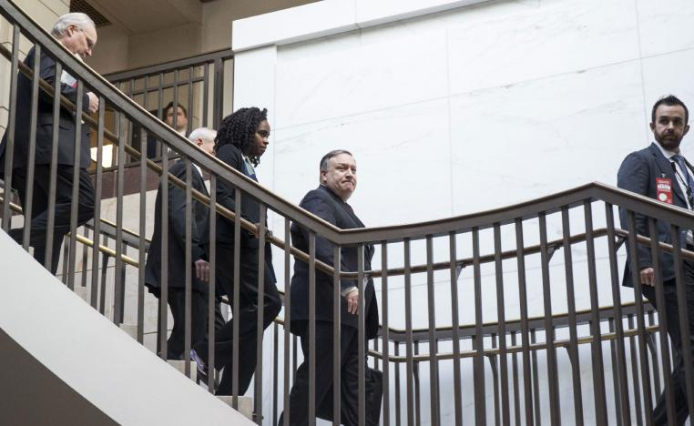 US Secretary of State Mike Pompeo walks to a briefing with members of the Senate to discuss developments in Saudi Arabia on Capitol Hill on November 28, 2018 in Washington, DC.