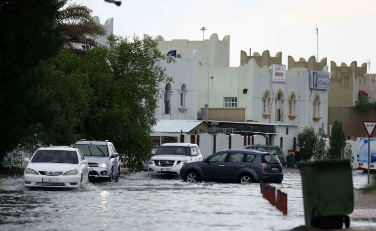 Roads flooded and workers were seen mopping up inside office buildings