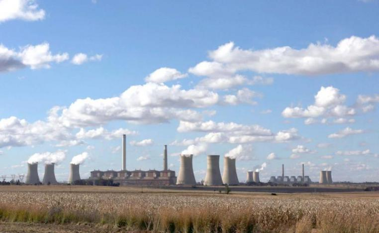 Open to debate. Smoke rises from the cooling towers of the Matla Power Station, a coal-fired power plant in South Africa.