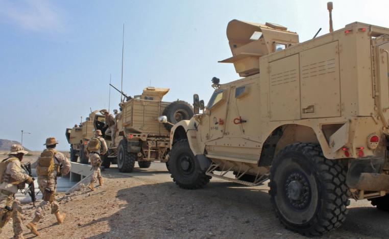 Soldiers loyal to Saudi-led coalition forces are seen in the southern Yemeni port of Aden.