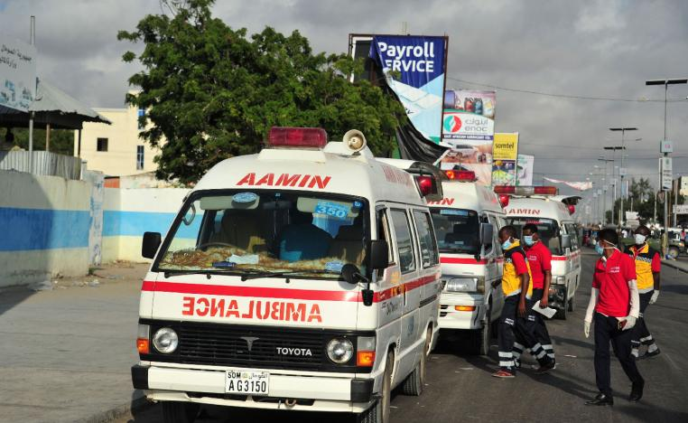 Somali ambulances carrying severely injured patients after an explosion in Mogadishu wait to access the airport where the wounded will be evacuated on Turkish military planes on October 16, 2017.