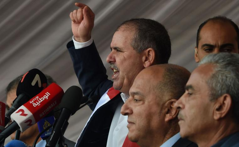 General Secretary of the Tunisian General Labour Union (UGTT) Noureddine Taboubi (C) gives a speech during a civil servants strike in the capital Tunis on November 22, 2018.