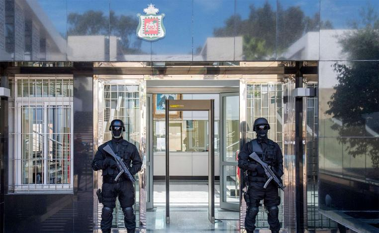 Members of Morocco's anti-terrorism security service stand guard outside BCIJ headquarters