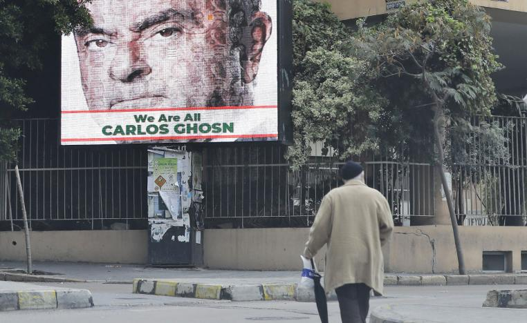 A portrait of former Nissan chief Carlos Ghosn is seen on a billboard in his support at a street in Beirut on December 6, 2018.