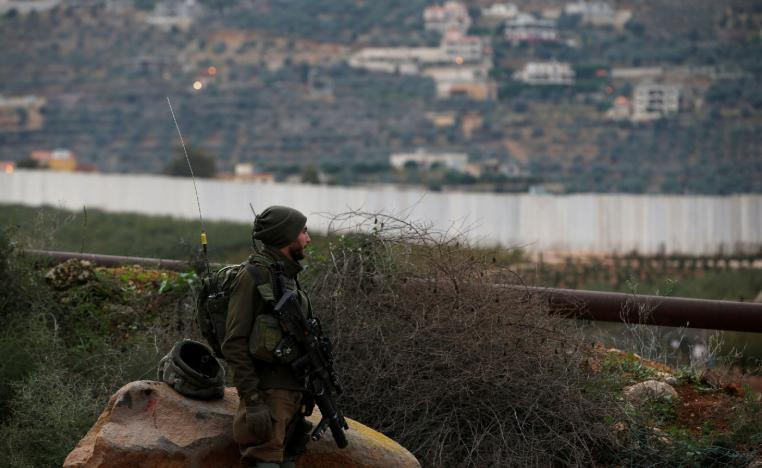 An Israeli soldier guards near the border with Lebanon on December 5, 2018.