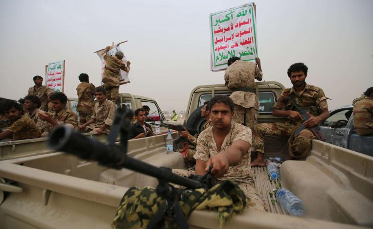 Houthi fighters ride on the back of trucks as they take part in a parade in the Red Sea port city of Hodeidah, Yemen August 24, 2017.