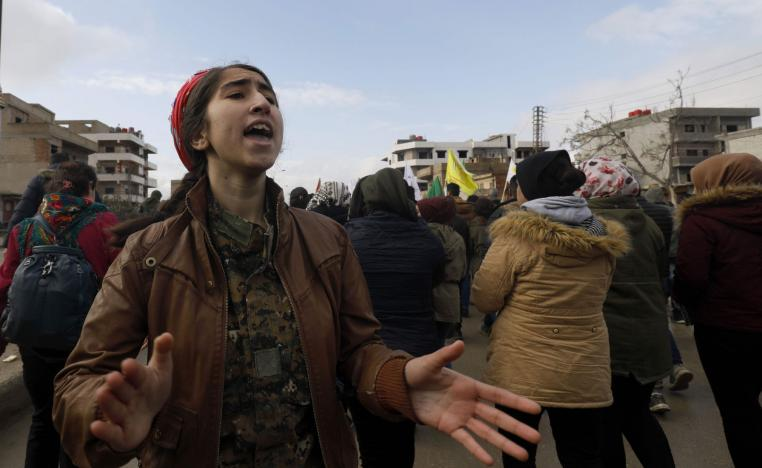Syrian Kurds take part in a demonstration in the northeastern Syrian Kurdish-majority city of Qamishli on December 28, 2018, against threats from Turkey to carry out a fresh offensive following the US decision to withdraw their troops.