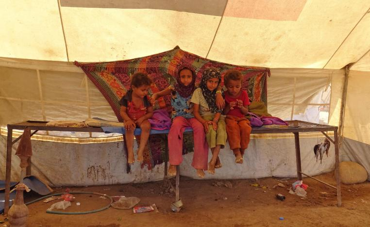 Yemeni children gather inside a tent at a camp for displaced people in the Khokha district of the western province of Hodeidah on December 12, 2018.