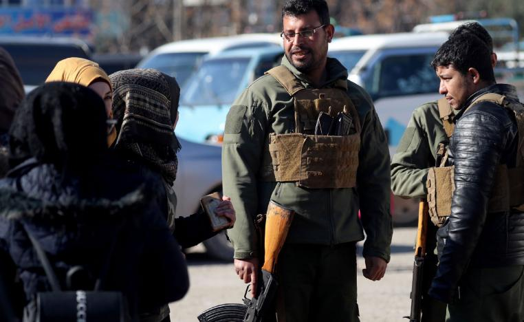 Armed men stand guard the streets in the northern Syrian town of Manbij, controlled by Kurdish-dominated Syrian Democratic Forces (SDF), on December 29, 2018.