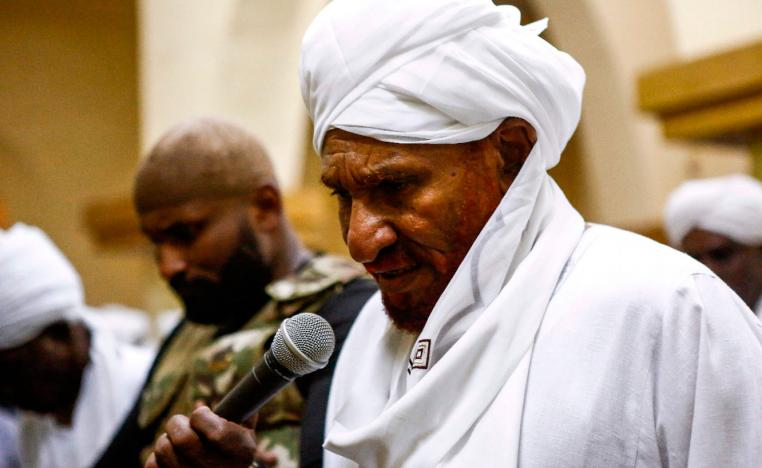 Sadiq al-Mahdi, Sudan's ex-prime minister and leader of the opposition Umma Party, prays in a mosque in the capital Khartoum's twin city of Omdurman on December 19, 2018.