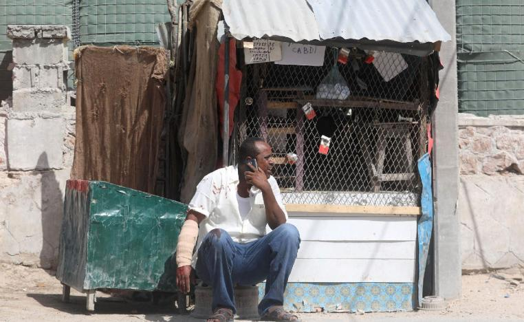 A civilian, injured following an explosion near the president's residence, uses his mobile phone as he waits for medical attention in Mogadishu, Somalia December 22, 2018.
