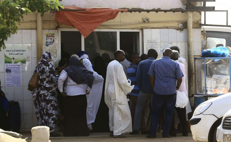 People queue in front of a bakery in the Sudanese capital Khartoum on August 26, 2018.