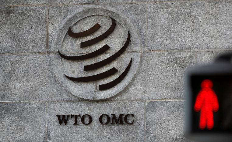 A logo is pictured outside the World Trade Organization (WTO) headquarters next to a red traffic light in Geneva, Switzerland, October 2, 2018.