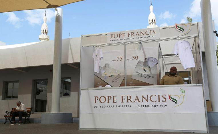 A man sells memorabilia for Pope Francis' upcoming trip to the UAE at St. Mary's Catholic Church in Dubai