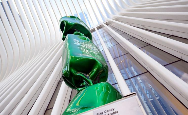 A sculpture with the flag of Saudi Arabia is part of an exhibit called 'Candy Nations'
