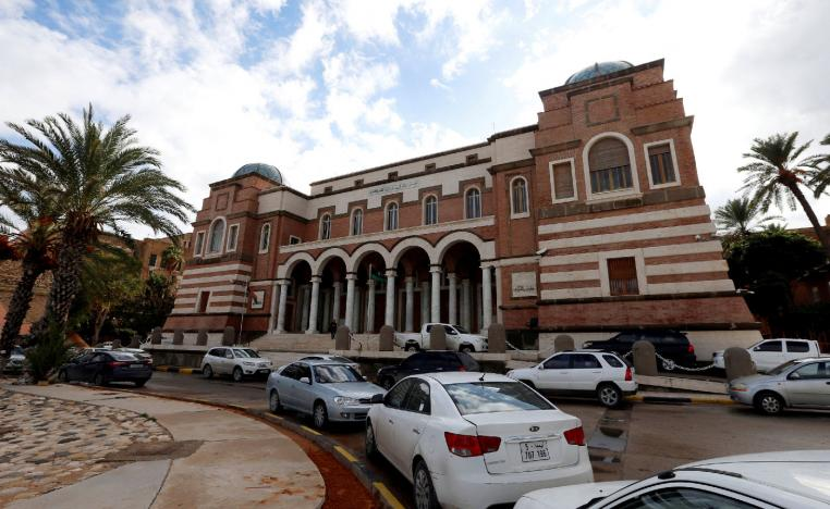 Cars are parked outside the Central Bank of Libya in Tripoli, Libya November 14, 2017.