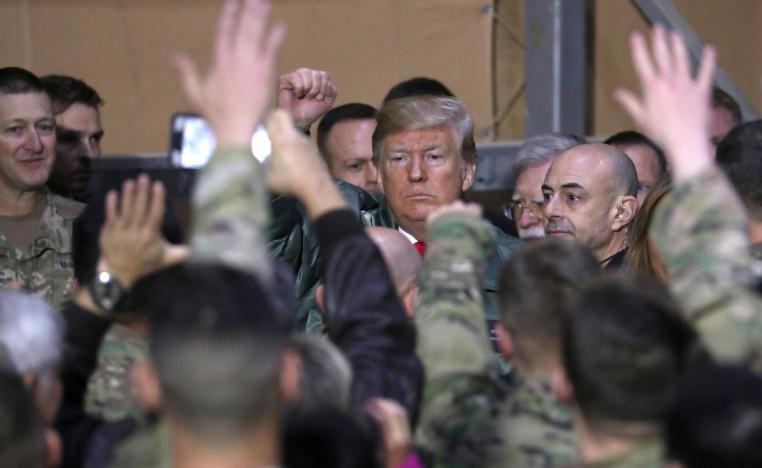 US President Donald Trump delivers remarks to U.S. troops on an unannounced visit to Al Asad Air Base, Iraq on December 26, 2018.