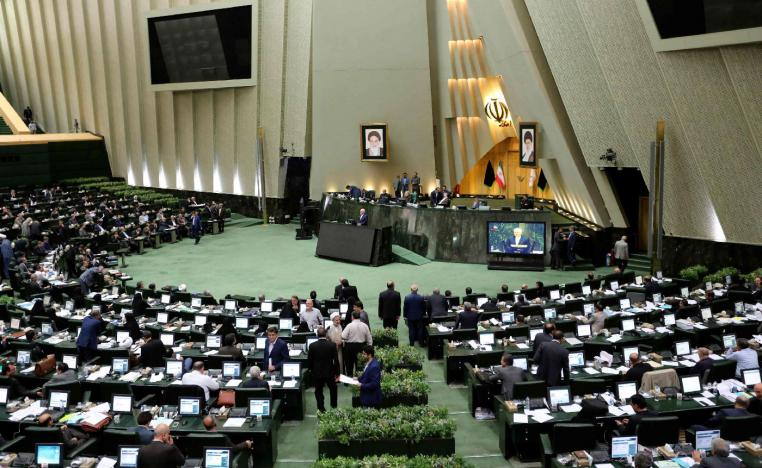 Iran's Foreign Minister Mohammad Javad Zarif delivers a speech to the parliament in Tehran on October 7, 2018, over a bill to counter terrorist financing.