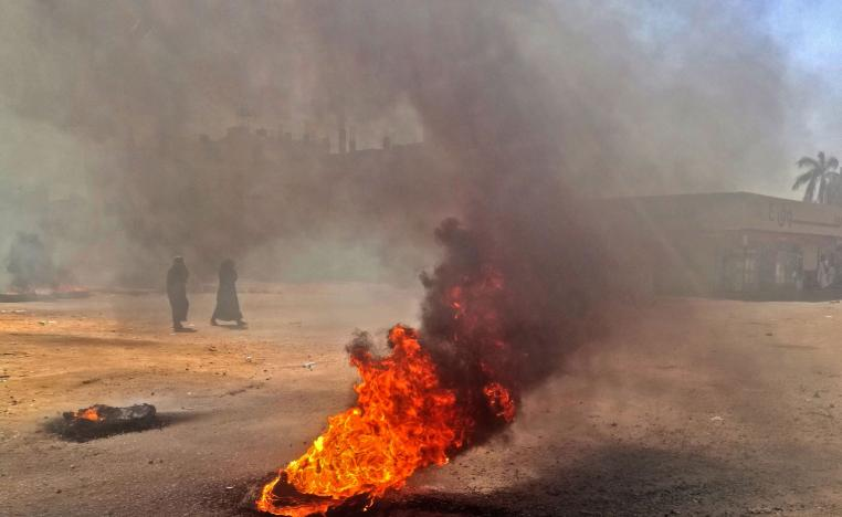 Sudanese protestors burn tires during an anti-government demonstration on January 18, 2019 in the capital Khartoum.