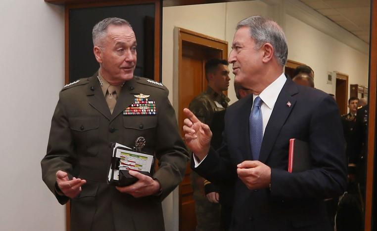 Turkish Defence Minister Hulusi Akar (R) and US Chairman of the Joint Chiefs of Staff Joseph Dunford speak during a meeting in Ankara on January 8, 2019.