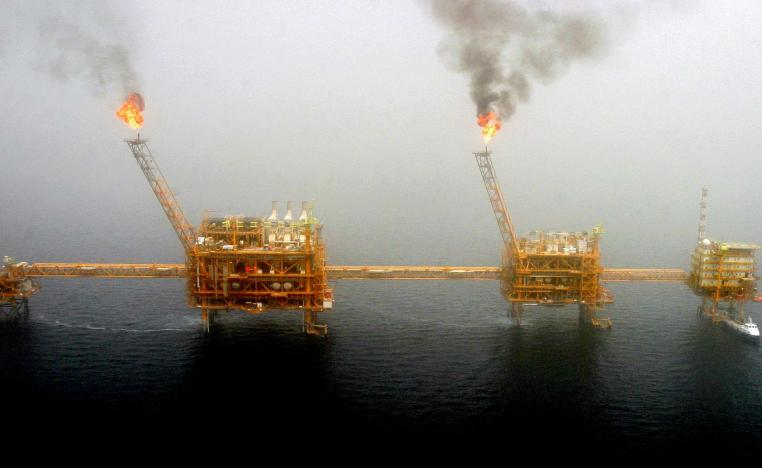 Gas flares from an oil production platform at the Soroush oilfields in the Persian Gulf, south of the Iranian capital Tehran, July 25, 2005.