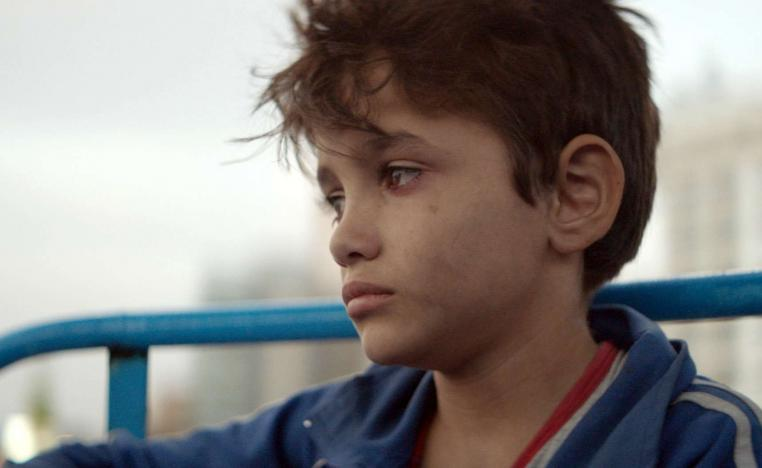 The protagonist is played by a young Syrian refugee, while another young cast member was thrown in jail during the shoot