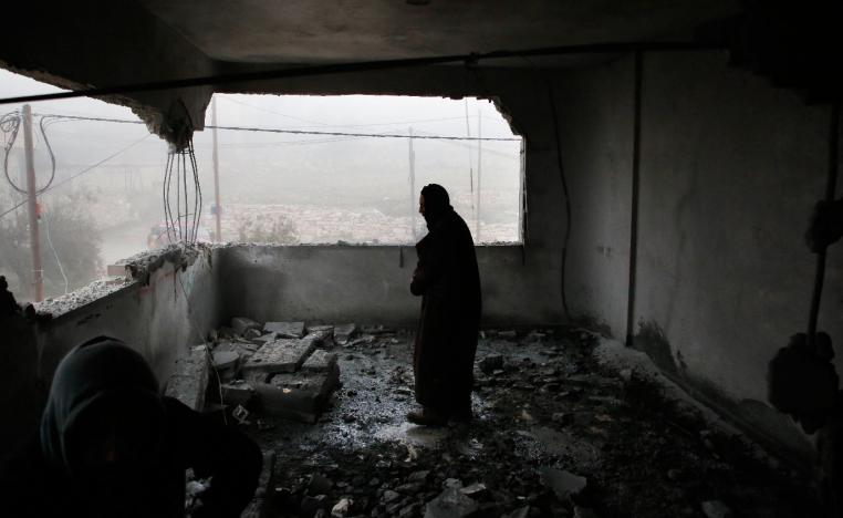 A Palestinian man checks the house of man accused of the fatal September stabbing of an Israeli-American, after it was partially demolished by Israeli forces on January 18, 2019 in village of Yatta in the occupied West Bank south of Hebron.