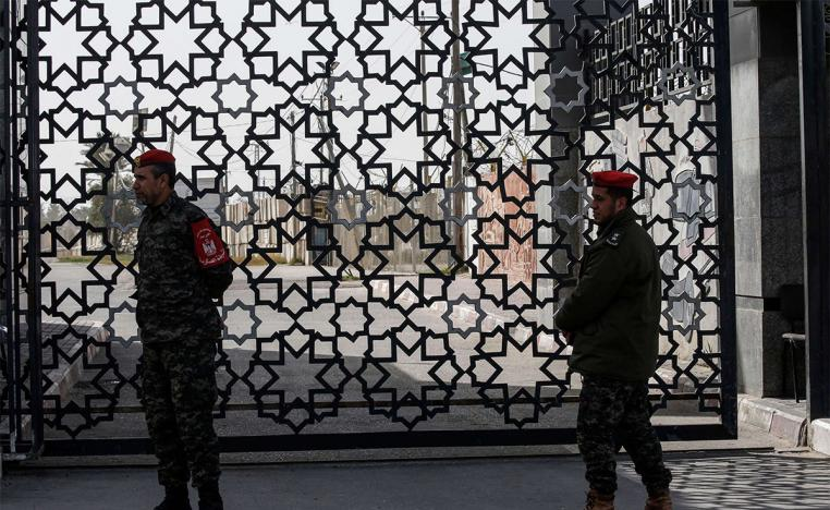 Palestinian security forces loyal to Hamas stand at the Rafah crossing point between Egypt and the southern Gaza Strip