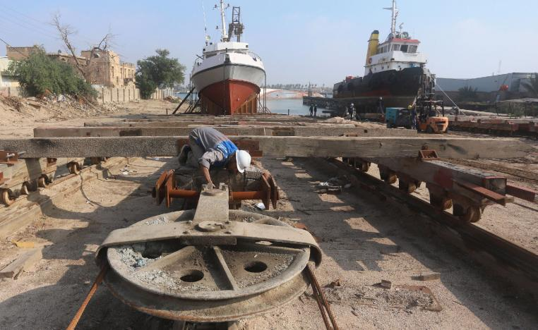 A worker inspects a pulley that pulls ships at a shipyard built by the British Army on Basra's docks in 1918, in Basra, Iraq December 23, 2018.