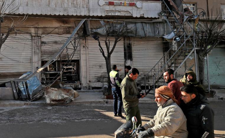 Syrians check the site a suicide attack targeting US-led coalition forces in the flashpoint northern Syrian city of Manbij which killed four US serviceman the previous day on January 17, 2019.